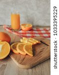 oranges on a cutting board and... | Shutterstock . vector #1033395229