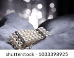 pearl bracelet wallpaper of... | Shutterstock . vector #1033398925