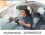 portrait of a man using... | Shutterstock . vector #1033400125