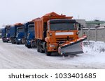 snow plows clearing a highway... | Shutterstock . vector #1033401685