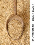 spoon of white quinoa seeds on... | Shutterstock . vector #1033416214