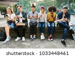 young adult friends using... | Shutterstock . vector #1033448461