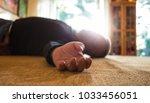 a man lies unconscious in his... | Shutterstock . vector #1033456051