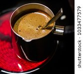 Small photo of Morning coffee is prepared on the induction cooker. Close-up view from above.