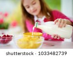 cute little girl enjoying her... | Shutterstock . vector #1033482739