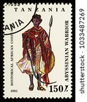 """Small photo of Moscow, Russia - February 26, 2018: A stamp printed in Tanzania, shows African man in traditional clothes, Abyssinian warrior, series """"Historical African Costumes"""", circa 1993"""
