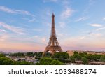 sunset by the eiffel tower | Shutterstock . vector #1033488274