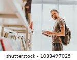 mature handsome man choosing...   Shutterstock . vector #1033497025