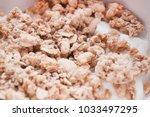breakfast muesli with yoghurt... | Shutterstock . vector #1033497295