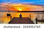 boy in the lake | Shutterstock . vector #1033501765