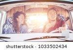 happy couple driving vintage... | Shutterstock . vector #1033502434
