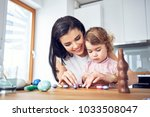 mother and child playing with... | Shutterstock . vector #1033508047