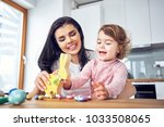 mother and child having fun... | Shutterstock . vector #1033508065