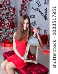 girl near the decorated... | Shutterstock . vector #1033517851