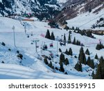 ski lift in almaty mountains.... | Shutterstock . vector #1033519915