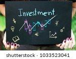 woman holding a blackboard... | Shutterstock . vector #1033523041