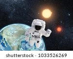 astronaut in outer space over... | Shutterstock . vector #1033526269