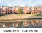 mirror reflection of typical... | Shutterstock . vector #1033529401