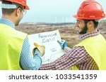 workers engineers reading and... | Shutterstock . vector #1033541359