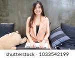 young smiling business asian... | Shutterstock . vector #1033542199