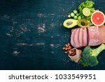 healthy food. raw meat  avocado ... | Shutterstock . vector #1033549951