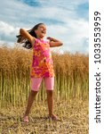 happy little girl in a field    ...   Shutterstock . vector #1033553959