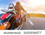 motorcycle driver riding in... | Shutterstock . vector #1033556077