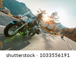 motorcycle driver riding... | Shutterstock . vector #1033556191