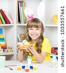 beautiful little girl dressed... | Shutterstock . vector #1033557661