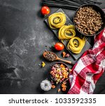 uncooked variety of pasta with... | Shutterstock . vector #1033592335