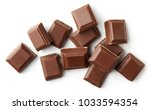 milk chocolate pieces isolated... | Shutterstock . vector #1033594354