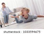 awful behavior. mischievous... | Shutterstock . vector #1033594675