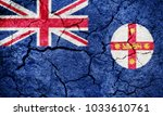new south wales flag on dry... | Shutterstock . vector #1033610761
