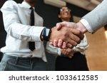cropped photo of handshake of... | Shutterstock . vector #1033612585