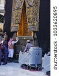 Small photo of Masjidil Haram,Mecca-January 28th,2018:A group of workers is cleaning the Multazam and its surounding. Cleaning process will take take few minutes before prayers time.