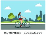 young girl riding bikes in the... | Shutterstock .eps vector #1033621999