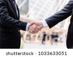 business people shaking hands ... | Shutterstock . vector #1033633051