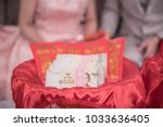 Small photo of Baht, Thai Baht, 1000 Baht banknote and red envelope placed on red cloth. At the Chinese wedding ceremony.
