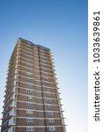 block of flats with blue sky | Shutterstock . vector #1033639861
