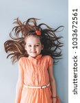 young girl with messy hair... | Shutterstock . vector #1033672561