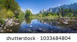 Panoramic view of famous Yosemite Valley with beautiful Merced river on a scenic sunny day with blue sky in summer, Yosemite National Park, California, USA - stock photo