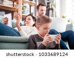family with laptop  tablet and... | Shutterstock . vector #1033689124