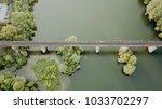 a big bridge over the river.... | Shutterstock . vector #1033702297