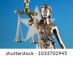 symbol of law and justice with... | Shutterstock . vector #1033702945