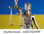 symbol of law and justice with... | Shutterstock . vector #1033702999