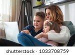 happy modern family using... | Shutterstock . vector #1033708759