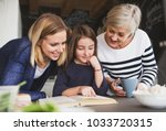 a small girl with mother and... | Shutterstock . vector #1033720315