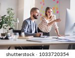 two business people with... | Shutterstock . vector #1033720354