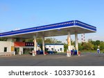 petrol gas station station at... | Shutterstock . vector #1033730161