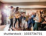 wedding guests are enjoying... | Shutterstock . vector #1033736731
